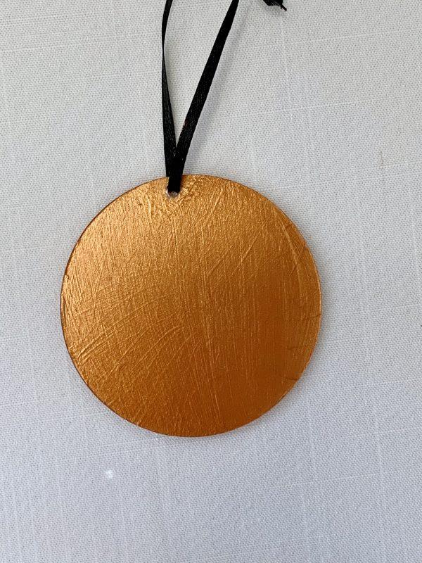 back of copper ornament